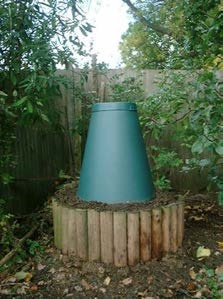 Example of a Green Cone installed within a raised bed